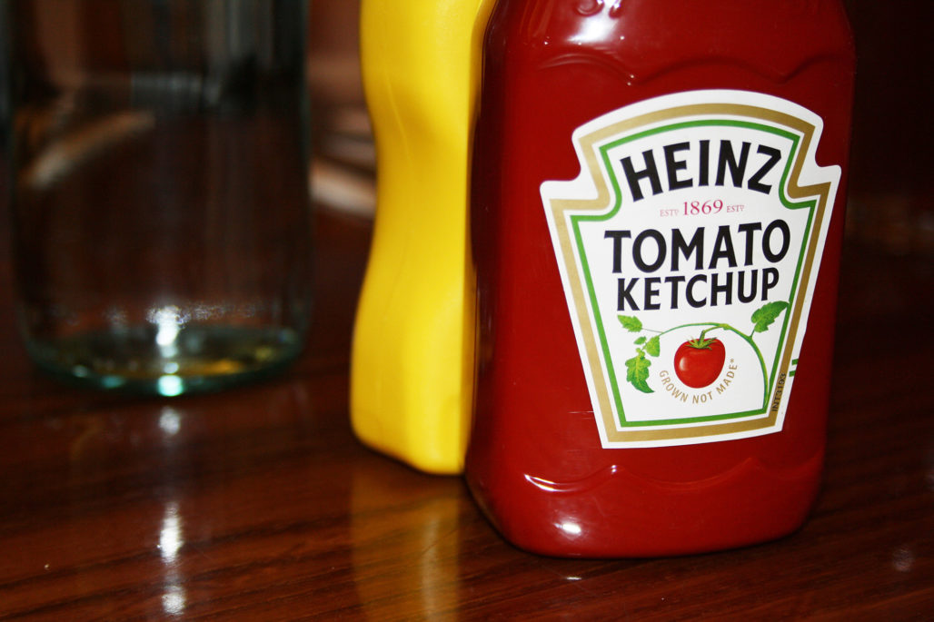 Heinz ketchup brand bottle on a table